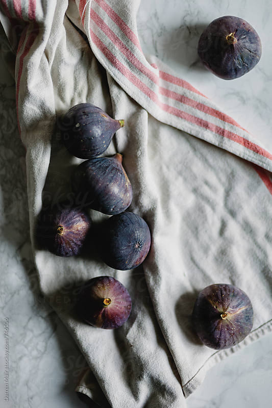 Fresh figs on a kitchen cloth. by Darren Muir for Stocksy United