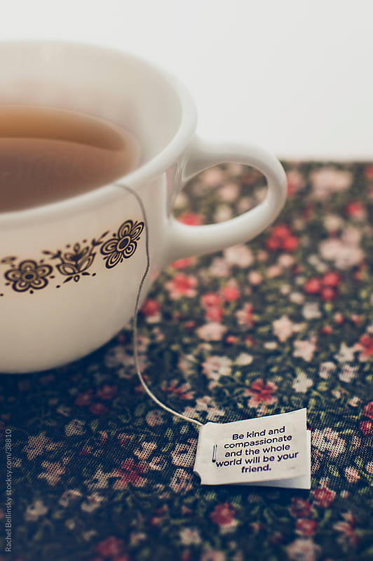 Tea cup with inspirational tea bag by Rachel Bellinsky for Stocksy United