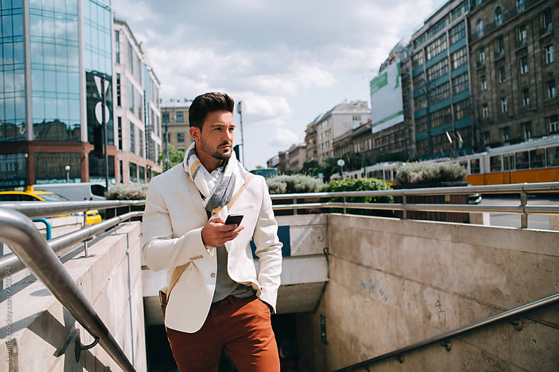 Handsome Man With a Mobile Phone on the Street by Lumina for Stocksy United