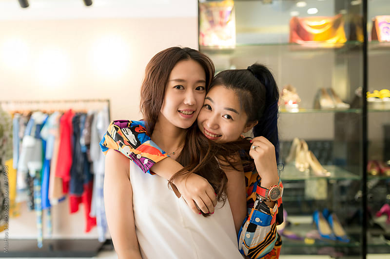 Two young fashion girl shopping at clothing store by Maa Hoo for Stocksy United