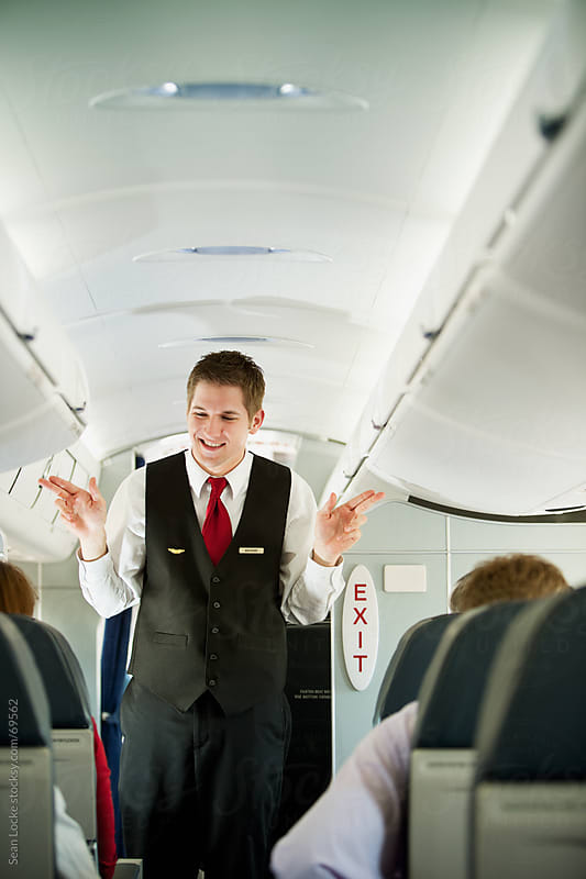 Airplane: Showing Where the Emergency Exits Are by Sean Locke for Stocksy United