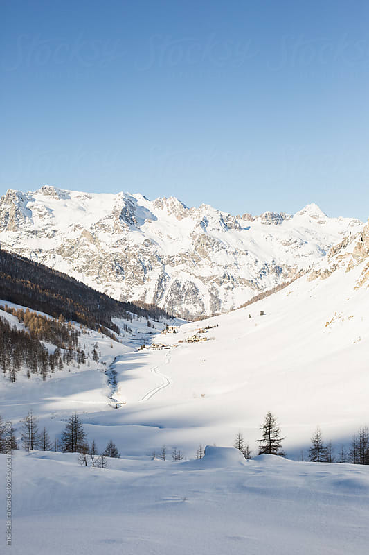 Landscape of snow-covered valley by michela ravasio for Stocksy United