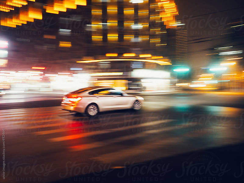 speeding cars by unite images for Stocksy United