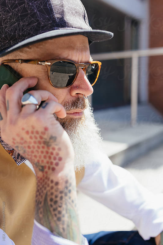 Eccentric Stylish Man Using His Phone Outdoor by Mattia Pelizzari for Stocksy United