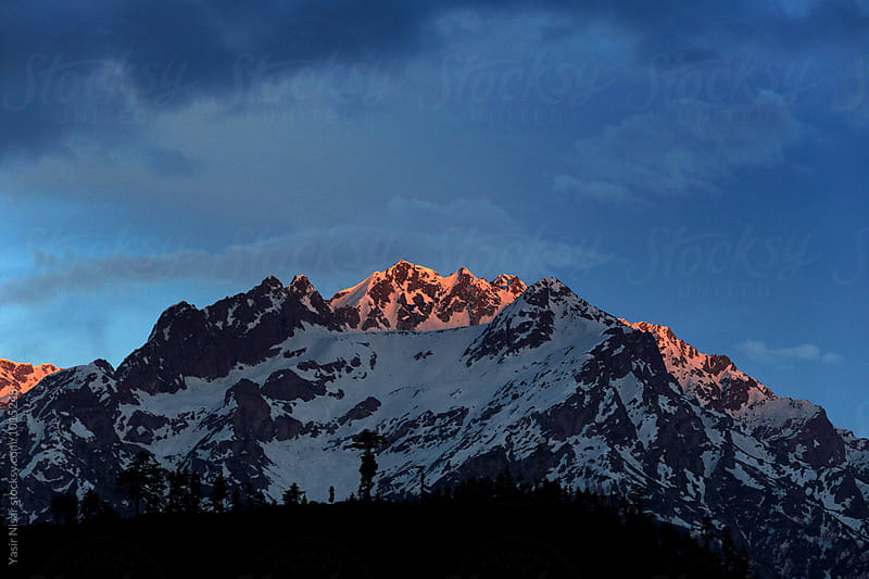 Sunset at snow covered mountains by Yasir Nisar for Stocksy United