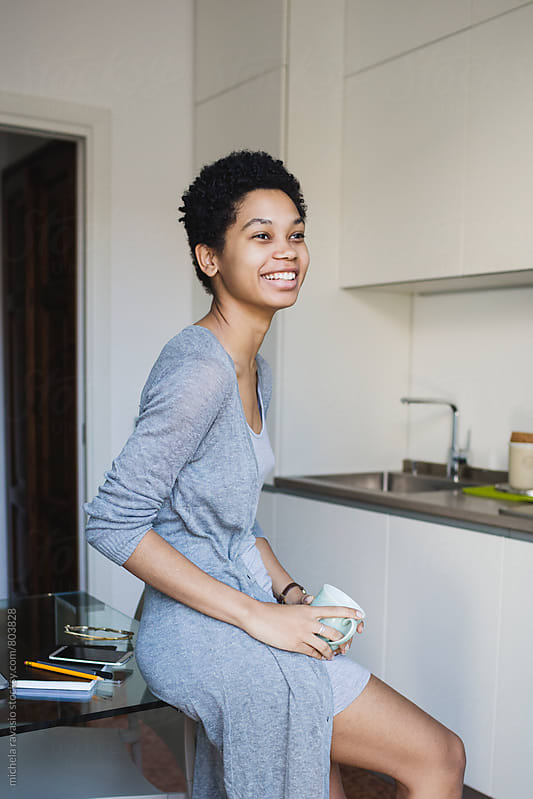 Smiling attractive young woman relaxing at home by michela ravasio for Stocksy United