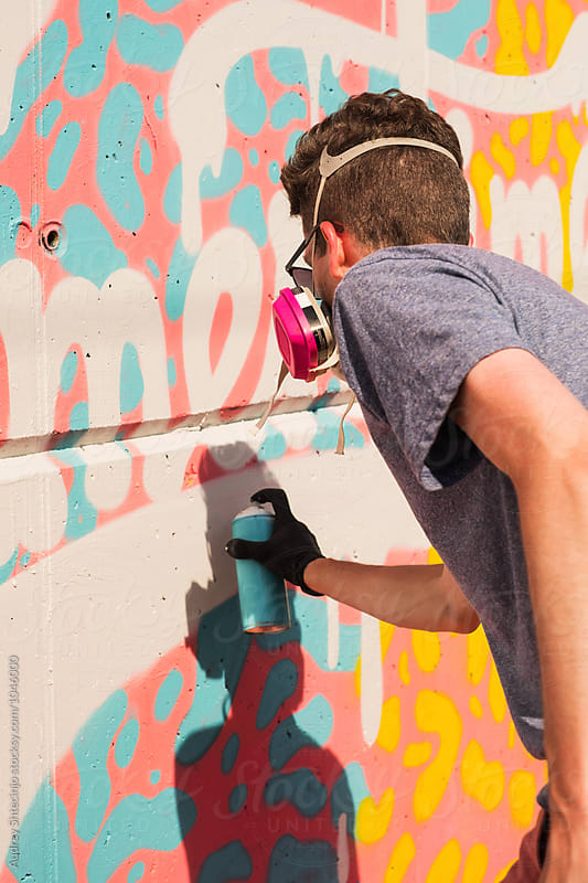 close up of street artist paining graffiti on wal by Audrey Shtecinjo for Stocksy United