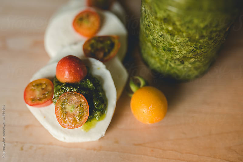 Yummy pesto caprese  by Courtney Rust for Stocksy United