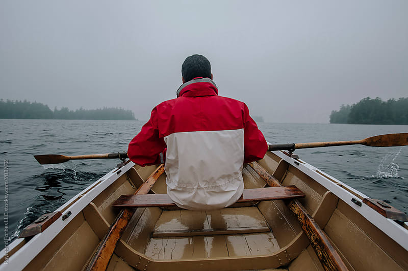 Man Rowing by Raymond Forbes LLC for Stocksy United