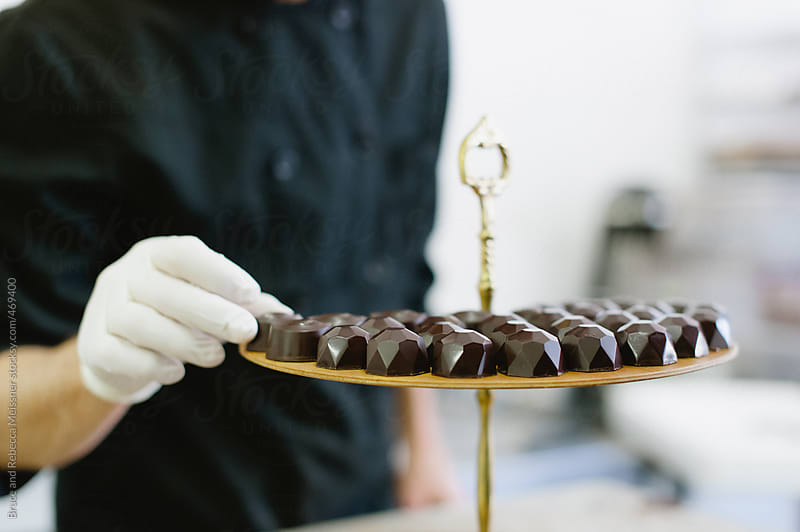 Chocolatier with Truffles by Bruce and Rebecca Meissner for Stocksy United