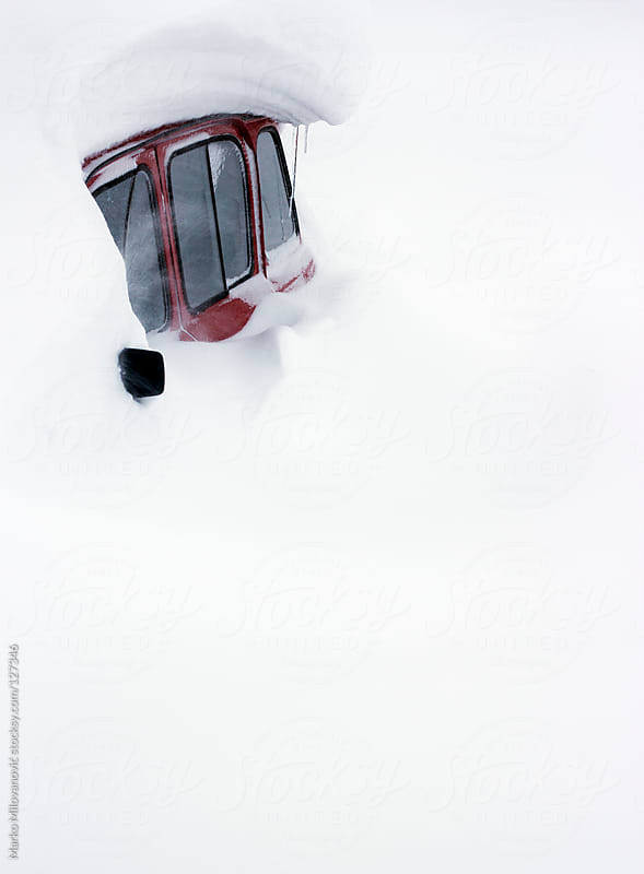 Car trapped in snow by Marko Milovanović for Stocksy United