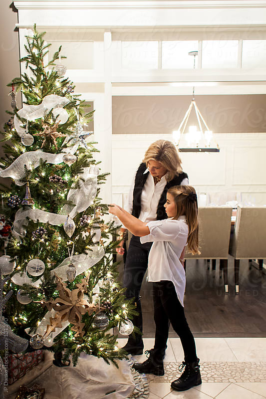Mother and Daughter Decorating Beautiful Christmas Tree by JP Danko for Stocksy United