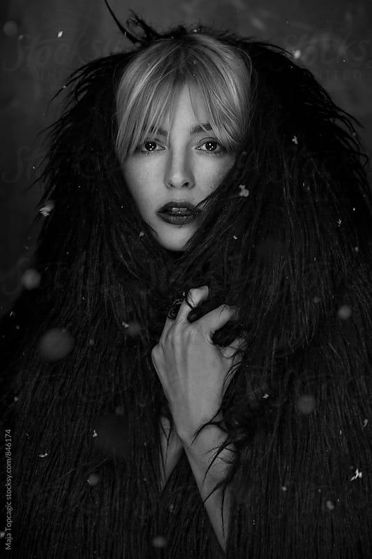Beautiful woman in fur coat by Maja Topcagic for Stocksy United