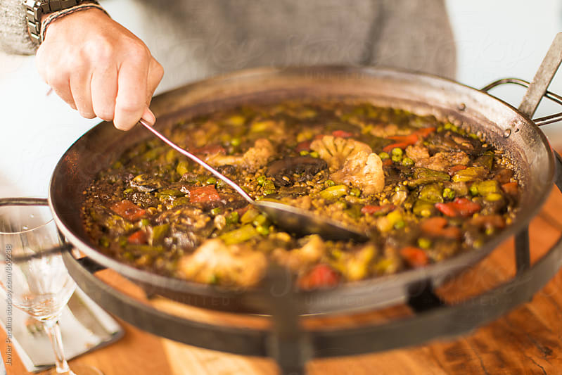 details of paella with vegetables  by Javier Pardina for Stocksy United