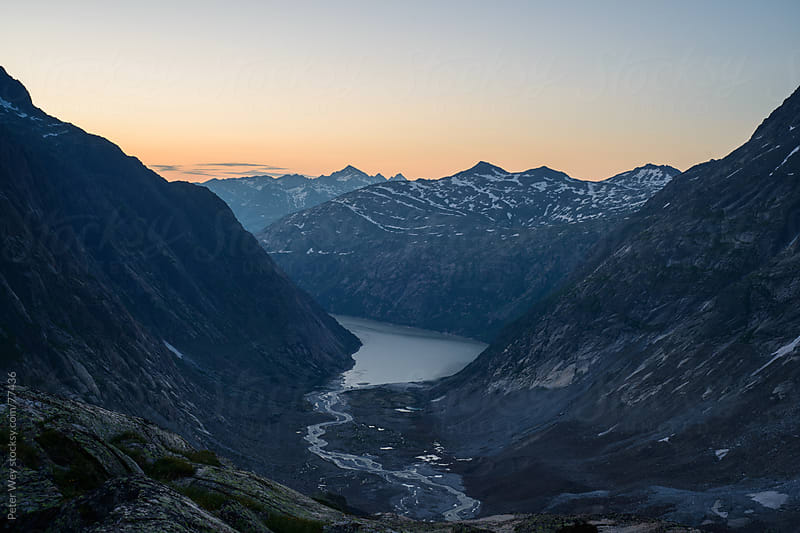 Lake Grimsel at sunrise. by Peter Wey for Stocksy United