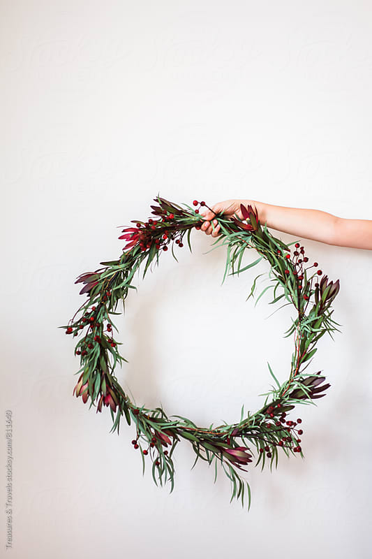 Woman holding a DIY Christmas Wreath by Treasures & Travels for Stocksy United