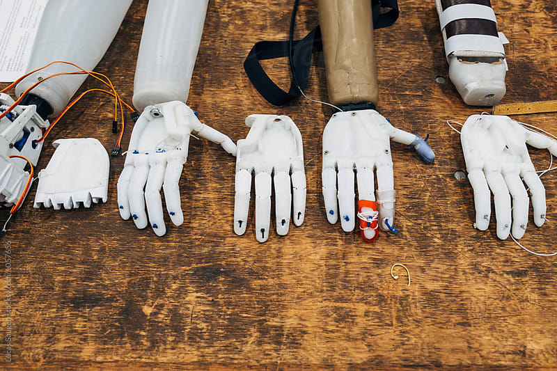 An assortment of DIY built 3D printed hands. by Lucas Saugen for Stocksy United