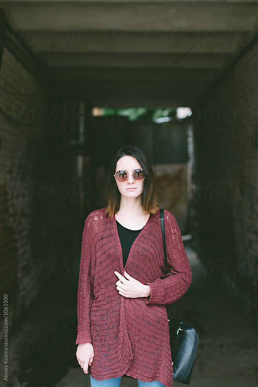 portrait of real young woman on the street by Vesna for Stocksy United