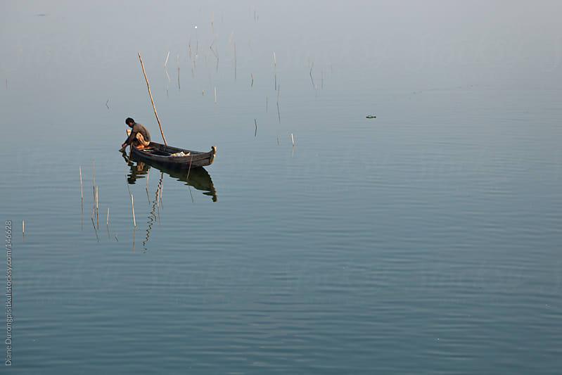 Fishing Alone by Diane Durongpisitkul for Stocksy United