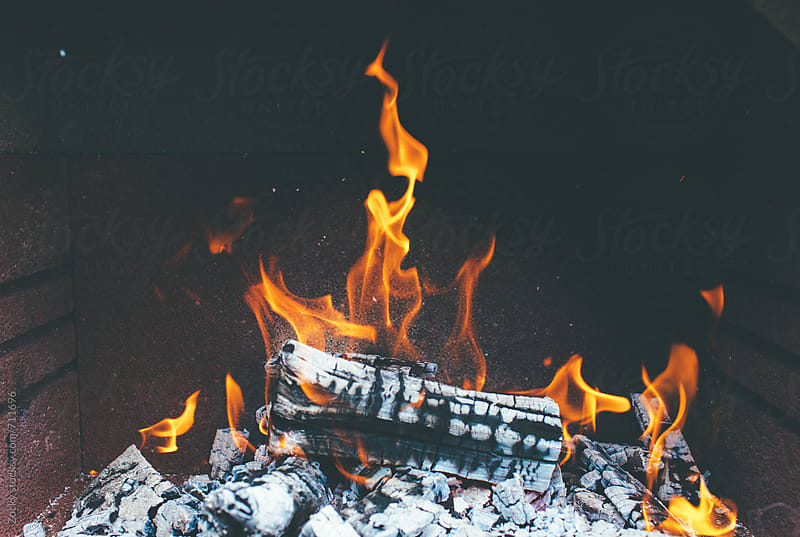 Detail of fire in bbq by Zocky for Stocksy United