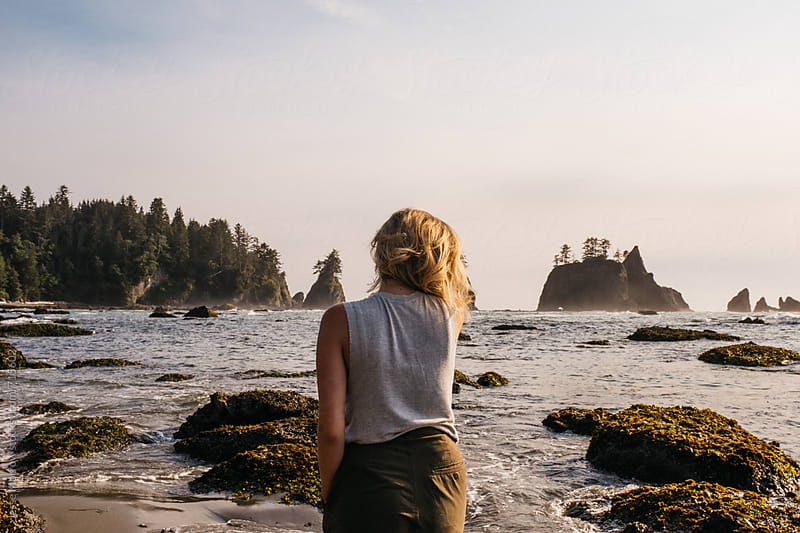 young female hiking and exploring rock formations and caves in northwest usa by Jesse Morrow for Stocksy United