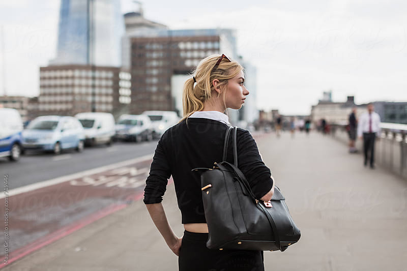 Young Business woman in the city by Mauro Grigollo for Stocksy United