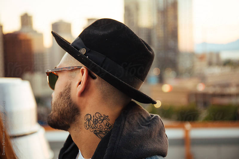 Tattooed man in the city. by Danny Pellissier for Stocksy United