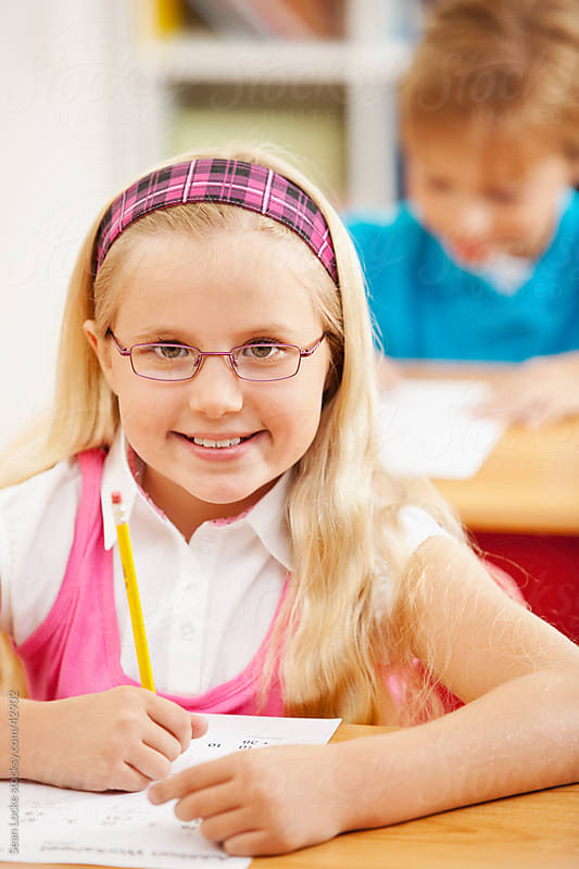 Classroom: Smart Girl Looks at Camera by Sean Locke for Stocksy United