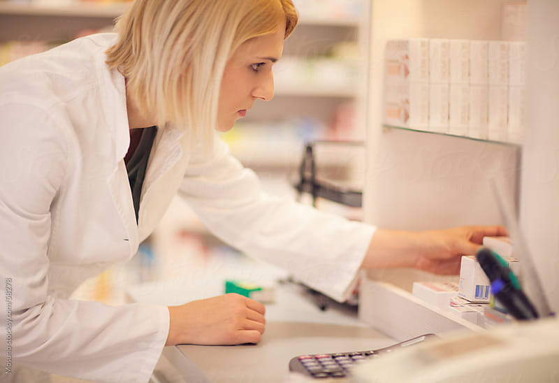 Female pharmacist working in a pharmacy. by Mosuno for Stocksy United