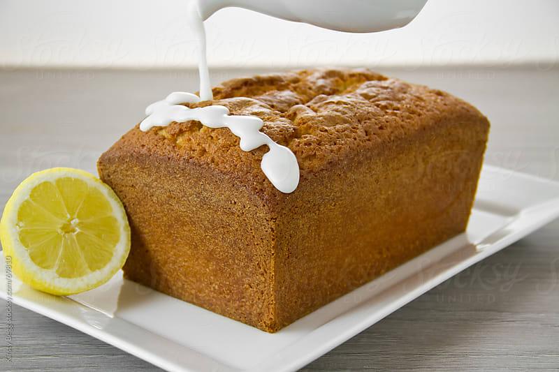 Lemon Loaf being glazed by Kirsty Begg for Stocksy United