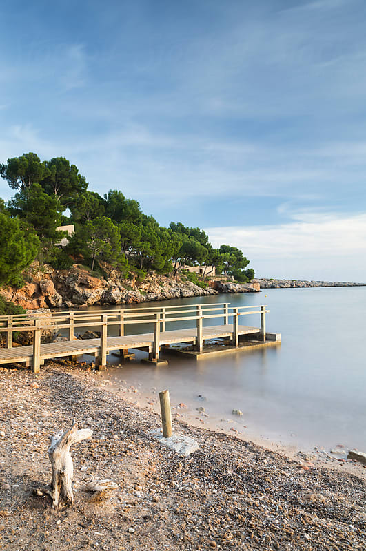 Small beach with footbridge to the sea by Marilar Irastorza for Stocksy United
