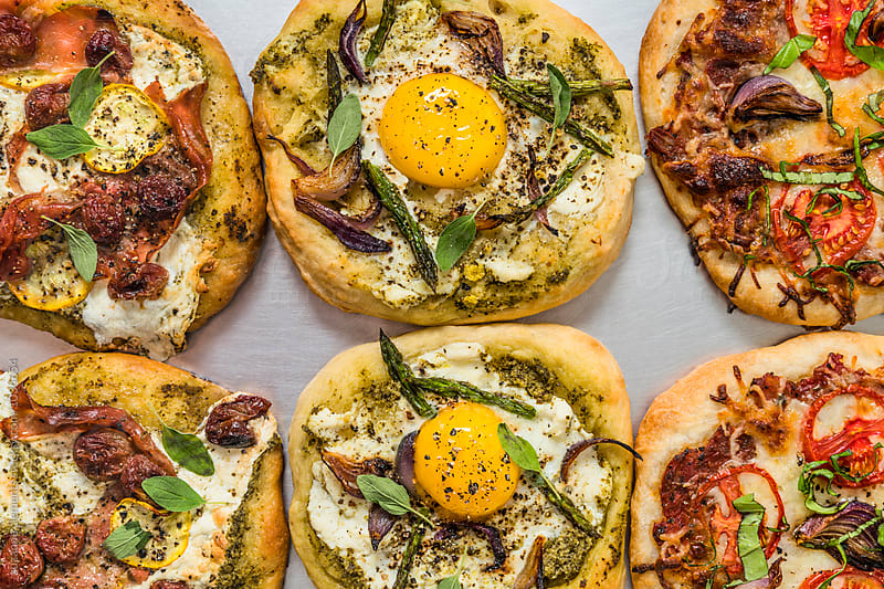 Rustic Pizzas by suzanne clements for Stocksy United