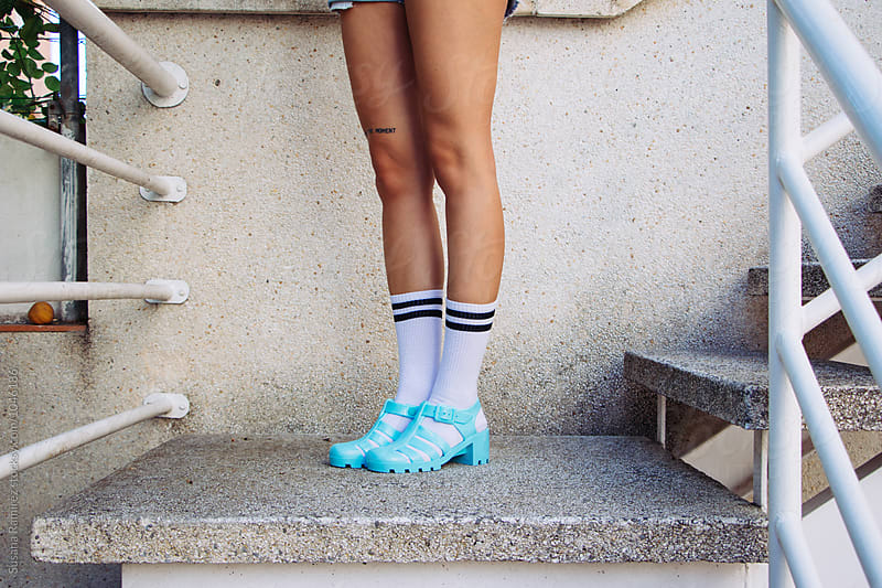 Woman's legs with socks and sandals by Susana Ramírez for Stocksy United