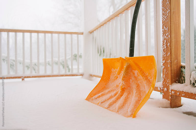 Snow Shovel on Porch by Raymond Forbes LLC for Stocksy United