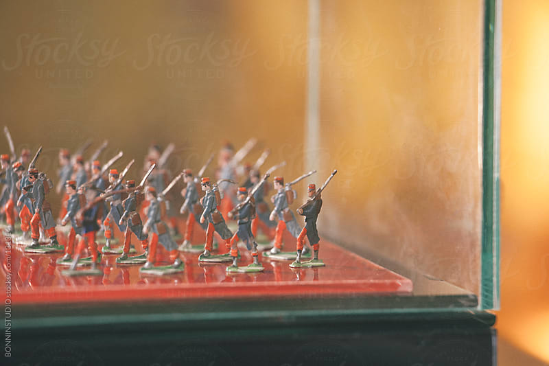 Vintage toy soldiers on a showcase. by BONNINSTUDIO for Stocksy United