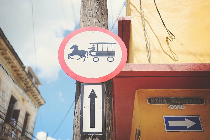 Horse and carriage street sign  by Kirsty Larmour for Stocksy United