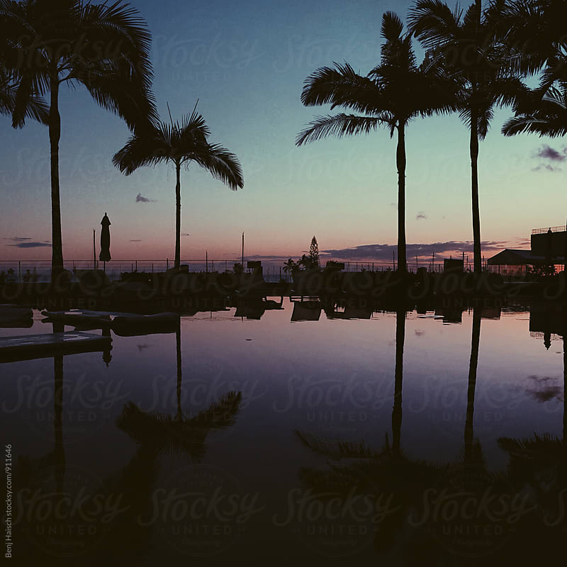 Sunset over pool by Benj Haisch for Stocksy United