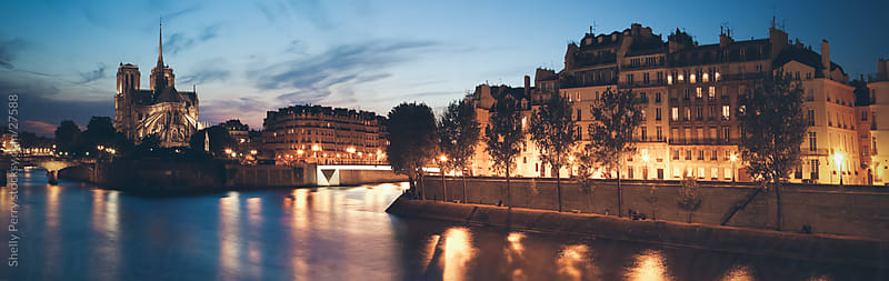 Panoramic at Sunset of Notre Dame and the Seine River  by Shelly Perry for Stocksy United