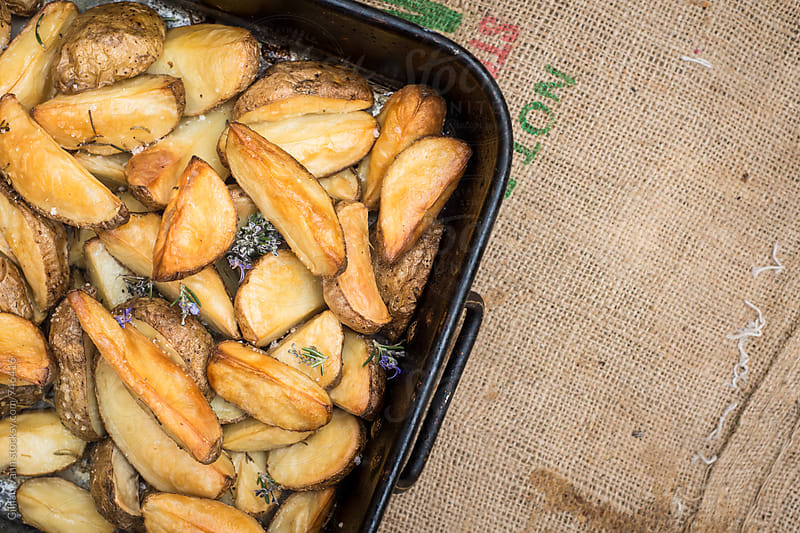 roasted potato wedges by Gillian Vann for Stocksy United