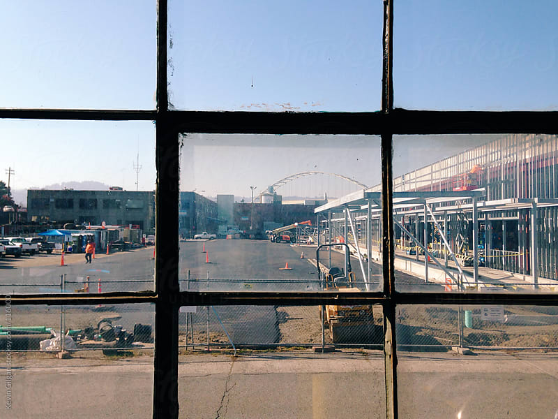 Window View of Industrial District  by Kevin Gilgan for Stocksy United