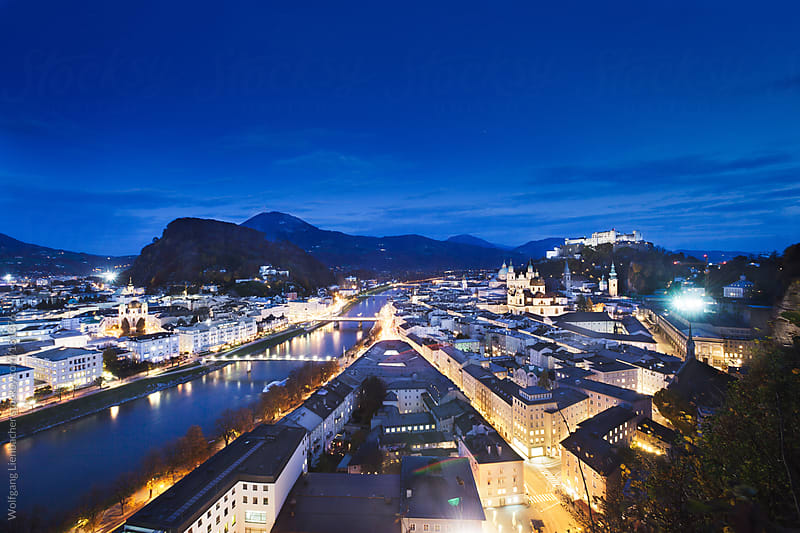 Salzburg Cityscape at night by Wolfgang Lienbacher for Stocksy United
