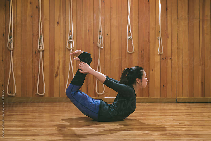 Woman practicing yoga by MaaHoo Studio for Stocksy United
