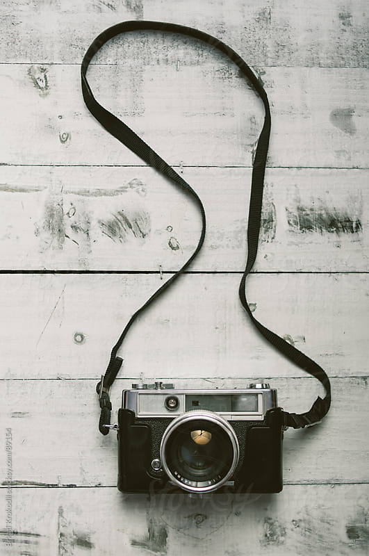 Retro Camera on a Wooden Table by Branislav Jovanović for Stocksy United