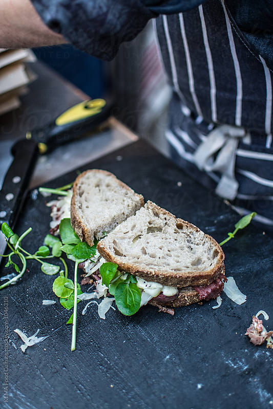 Pastrami sandwich on the making  by KEMA Food Culture for Stocksy United