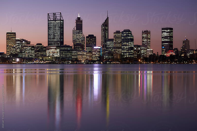 Perth City Skyline At Dusk by Adrian Young for Stocksy United