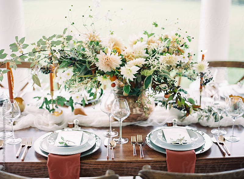 festive fall dinner table by Vicki Grafton Photography for Stocksy United