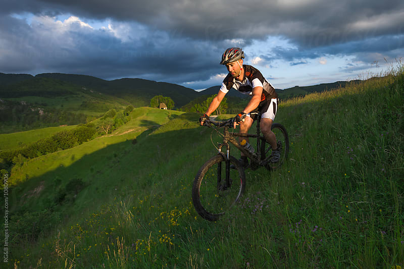 Man downhill mountain biking by RG&B Images for Stocksy United