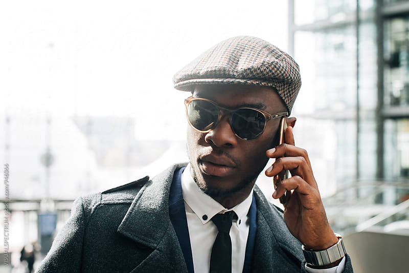 Cool Young Black Businessman Talking on Cellphone by Julien L. Balmer for Stocksy United