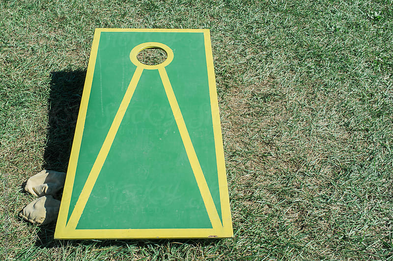 Cornhole game. by Melissa Ross for Stocksy United