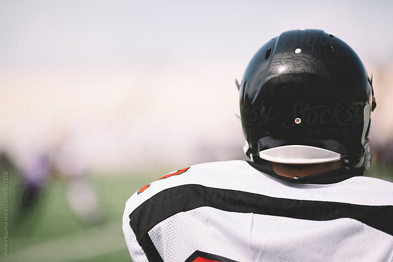 Athlete with black helmet in closeup by Alexey Kuzma for Stocksy United